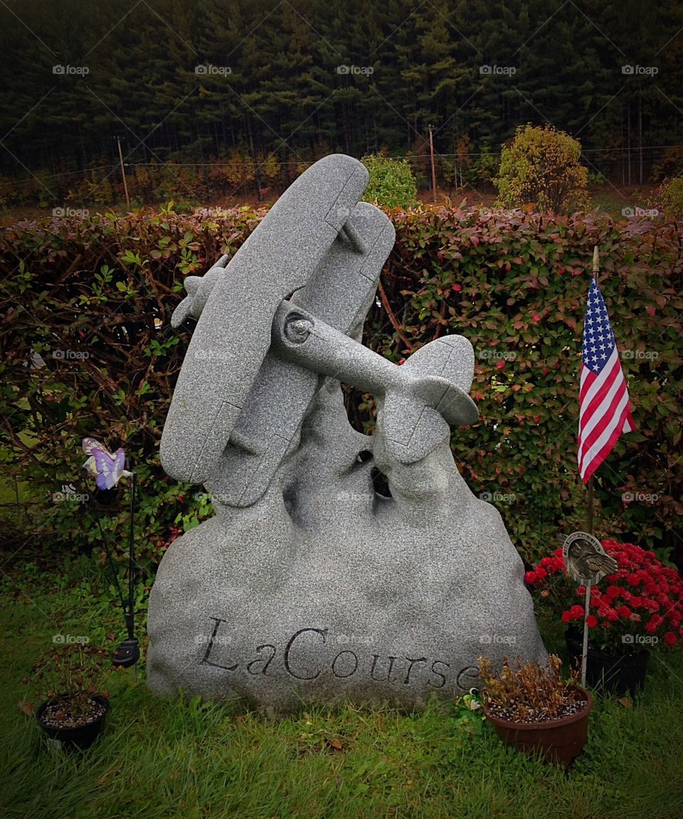 Fly away. Have you ever seen a headstone in the shape of a plane?