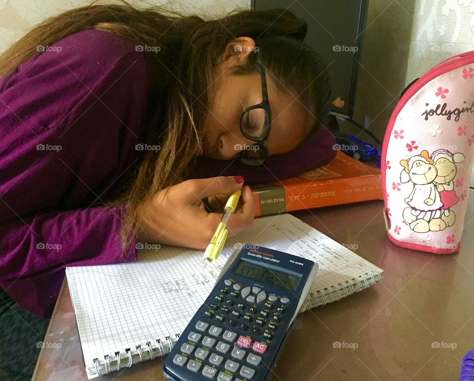 Close-up of girl slept while studying