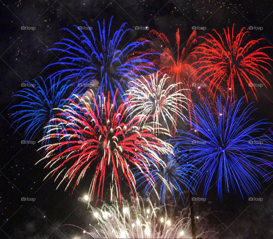 Red White and Blue exploding vivid fireworks.