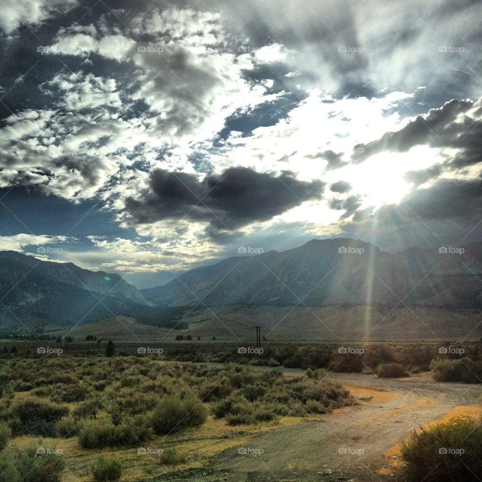 sky light grass clouds by adventurebug