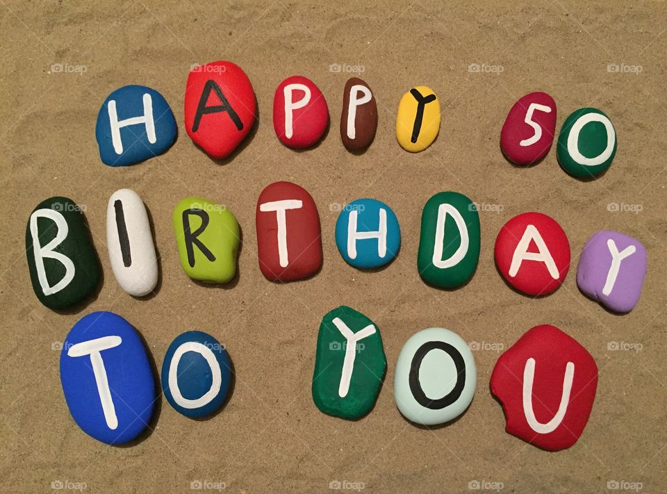 Happy Birthday to you, 50 years composition on colored stones