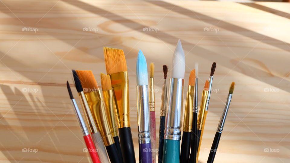 Variety of paintbrushes on table