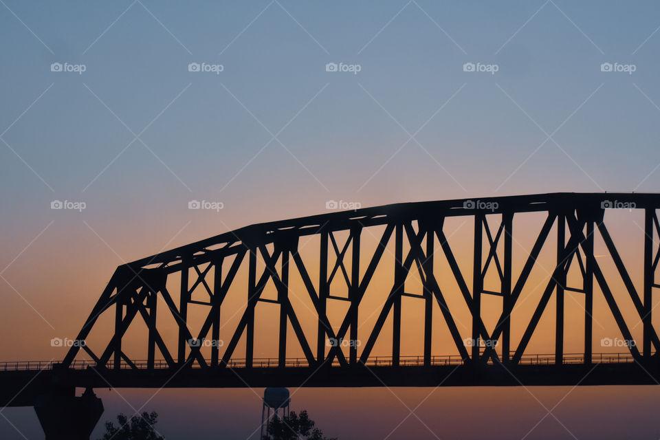 bridge in front of a sunset in South Dakota