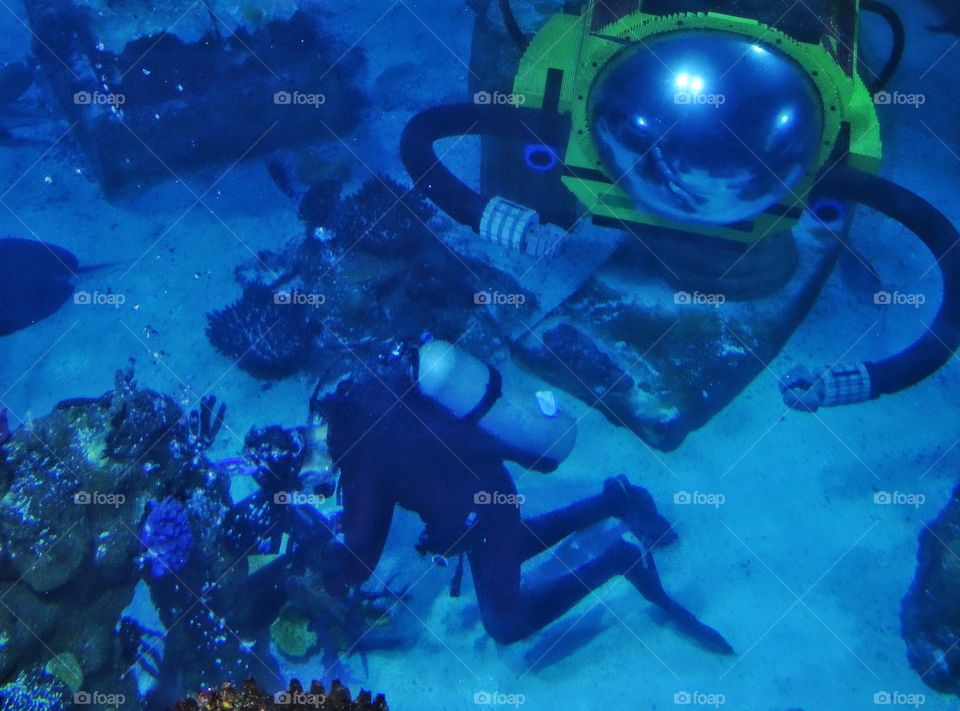 Underwater Exploration. Scuba Diver With Submarine Exploring A Coral Reef