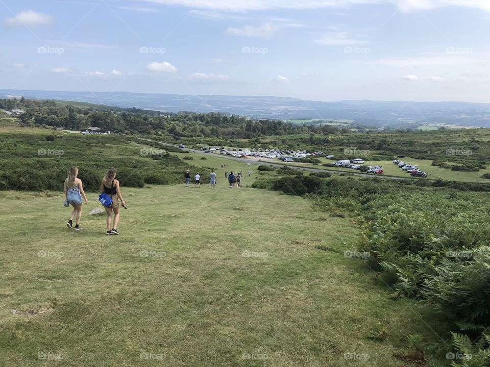 Visitors leaving Haytor on a remarkable job done, to view this famous rock on an historical day the hottest August bank holiday Monday ever.