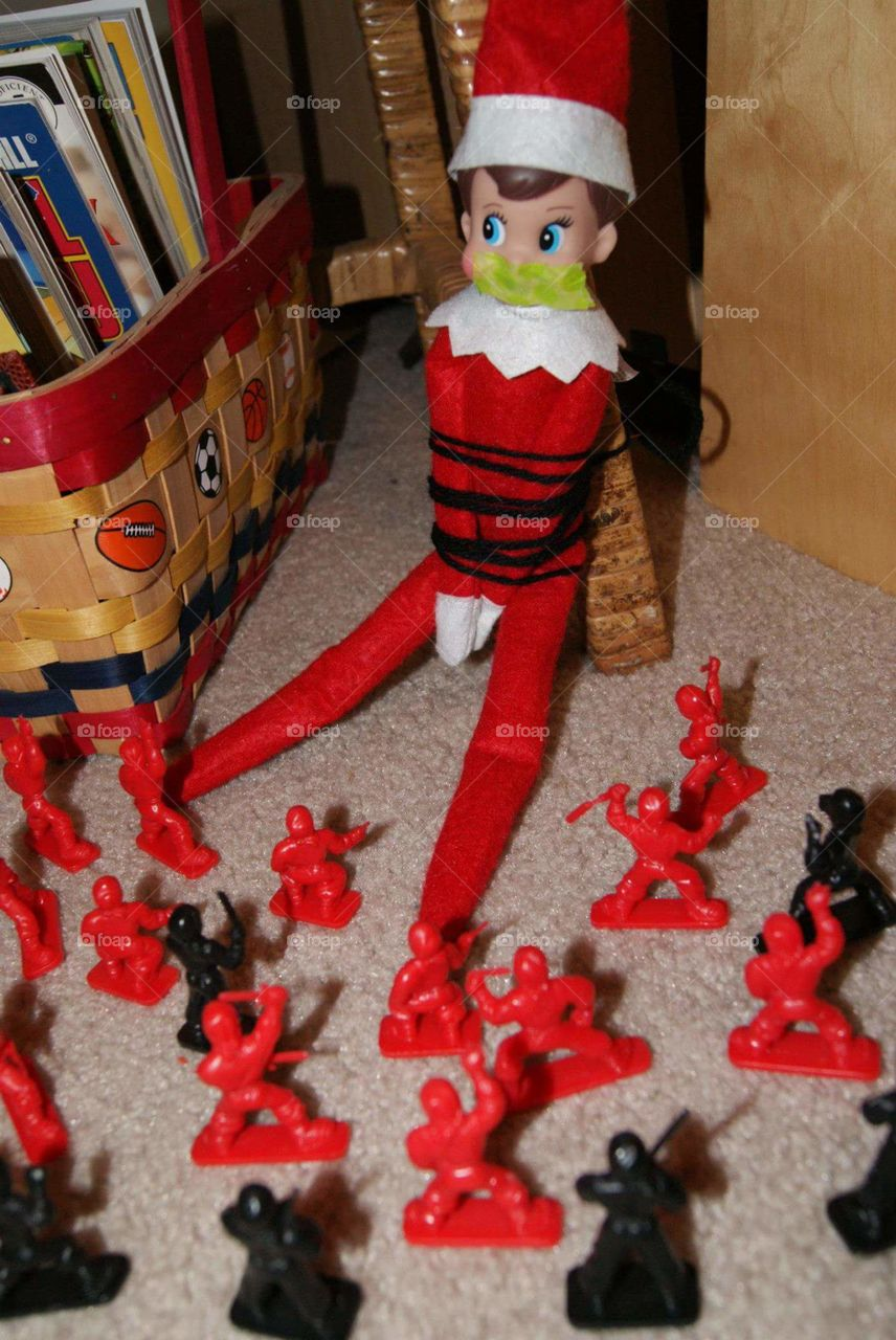 Captured. Elf on the Shelf is captured by tiny soldiers.