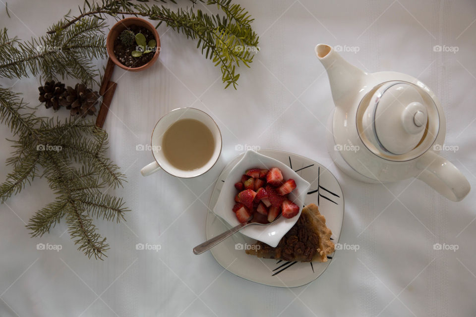Tea, strawberries and pecan pie in a festive flat lay
