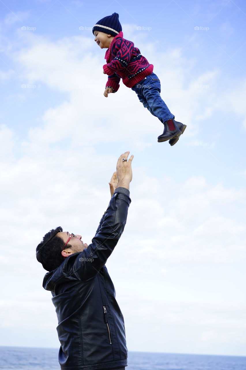 Father throwing his son