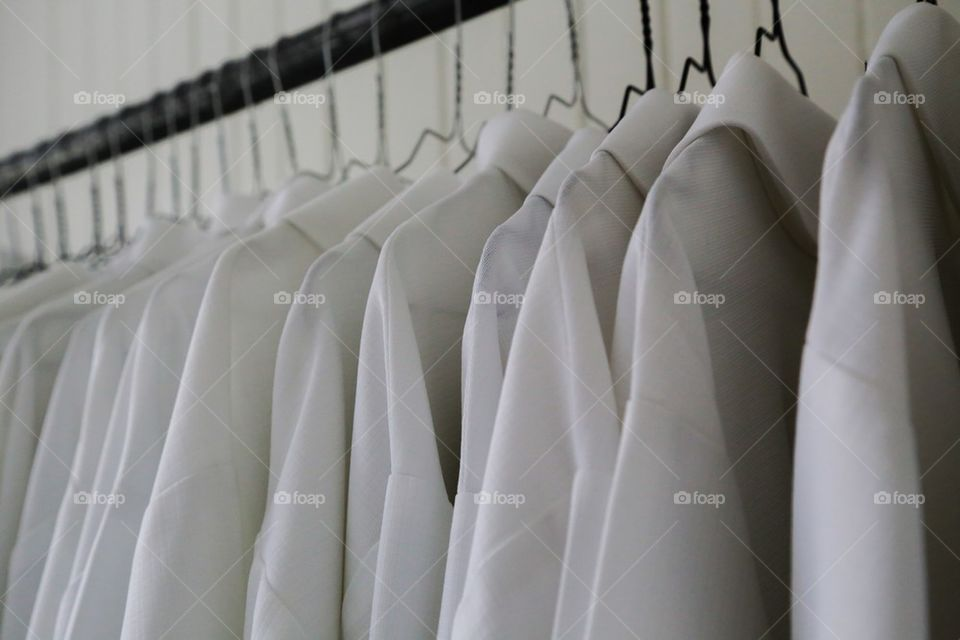 Close-up of clothes on hanger in closet