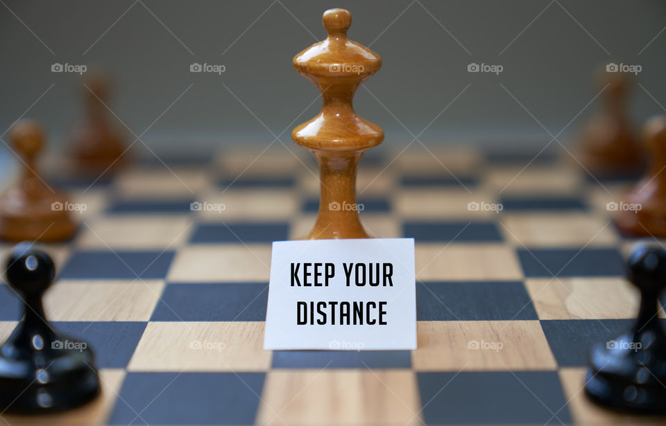 Chess piece expressing keep your distance with sign