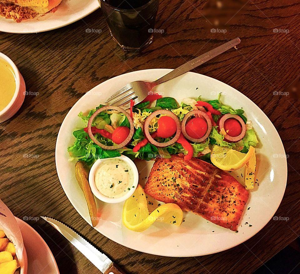 Salmon fish served with salad,, on health kick