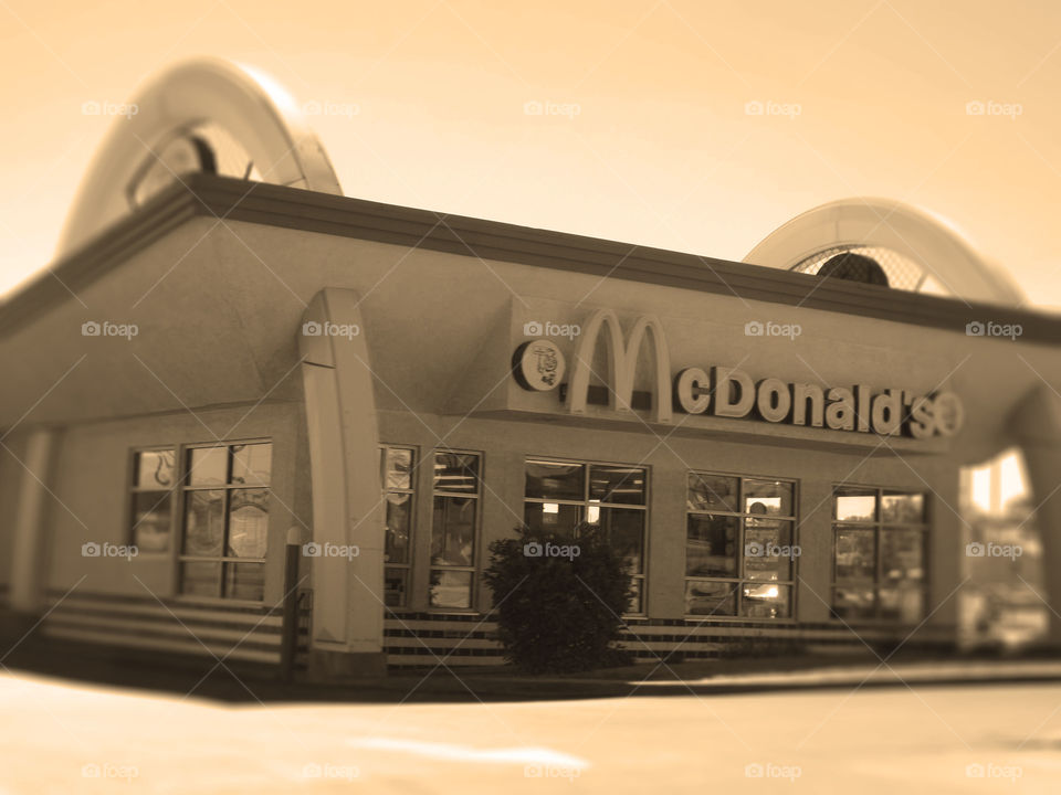 Retro 50's Style McDonald's, Mission, Kansas. I don't know if this is an old McDonald's or a newer one built in the style of the 1950's, but it's definitely different and cute. It's located on Johnson Drive in Mission, Kansas. I added a radial blur and sepia tone to enhance the retro look.
