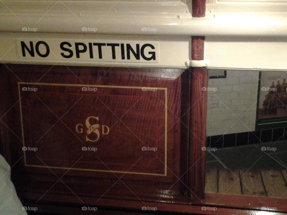 No spitting sign on old steam train