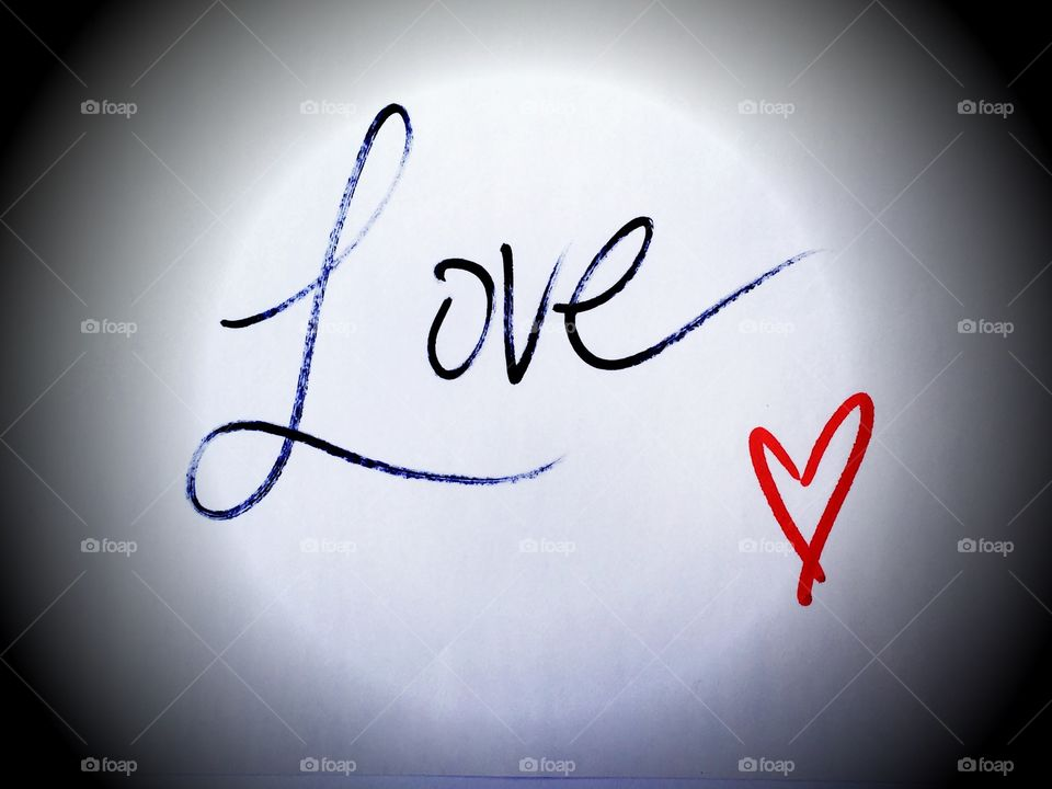 Love in cursive handwriting with heart