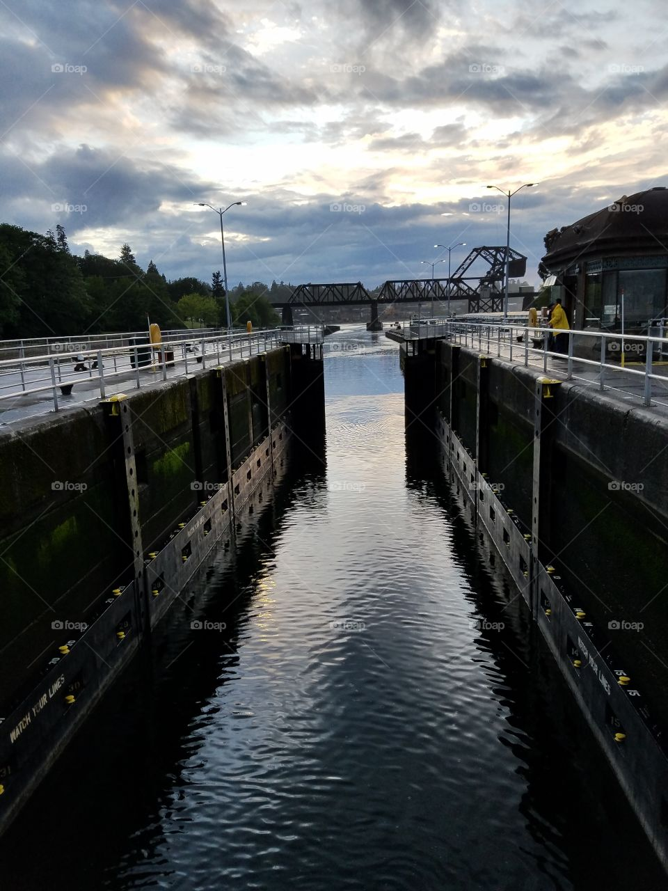 small chamber with gates on salt water side in motion. Hiram M Chittenden Locks. Seattle, Washington 5/19/2016