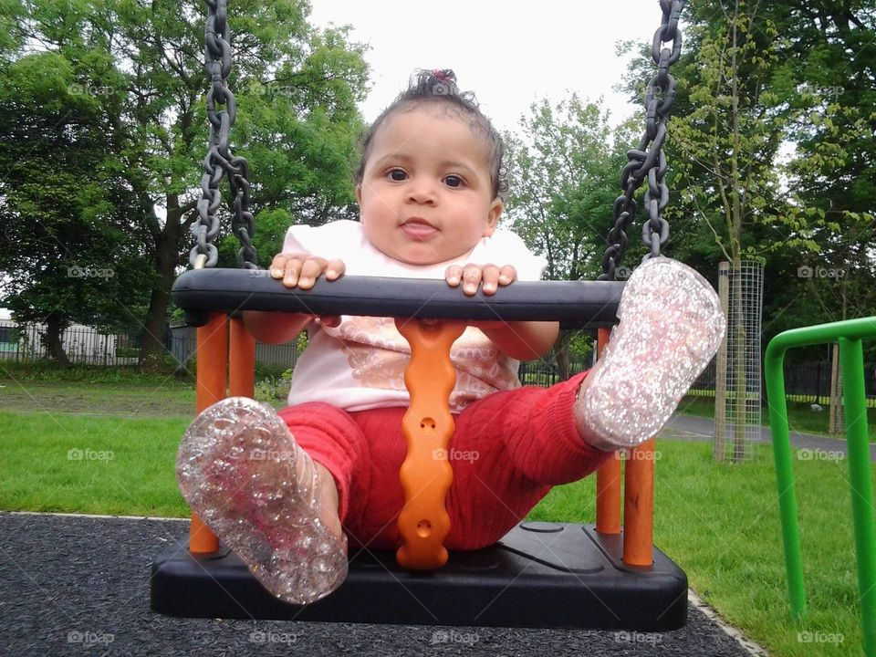 On the swings in the park