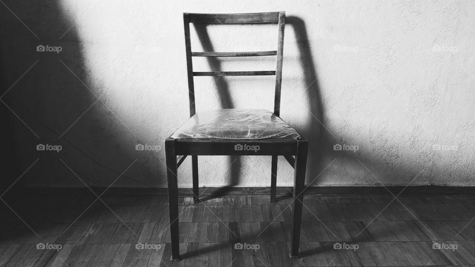 Wooden chair in empty room