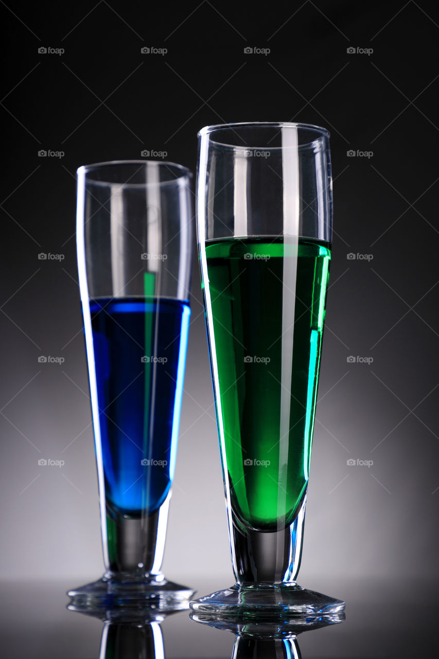 Blue and green Cocktail /  juice / alcohol in glasses