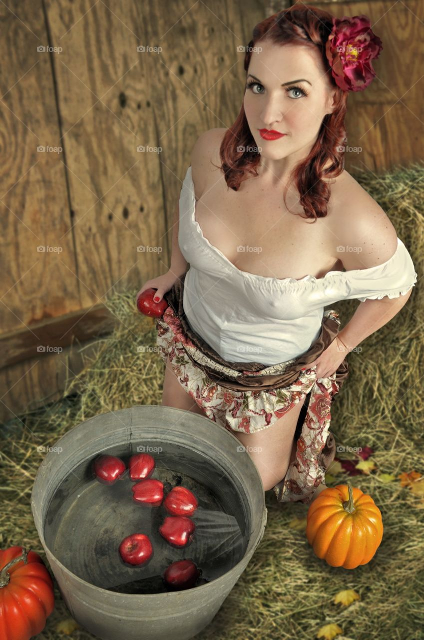 Attractive woman holding apple