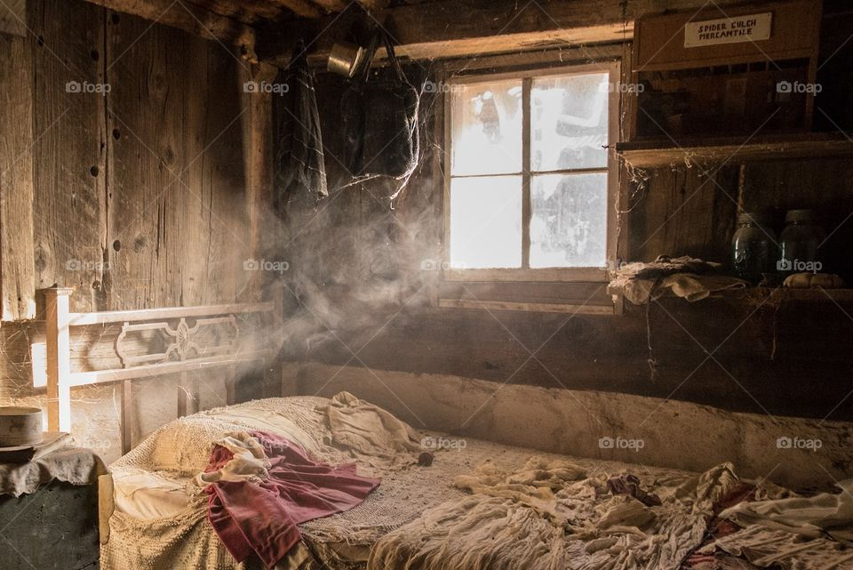 A bedroom in a cabin in Steins ghost town