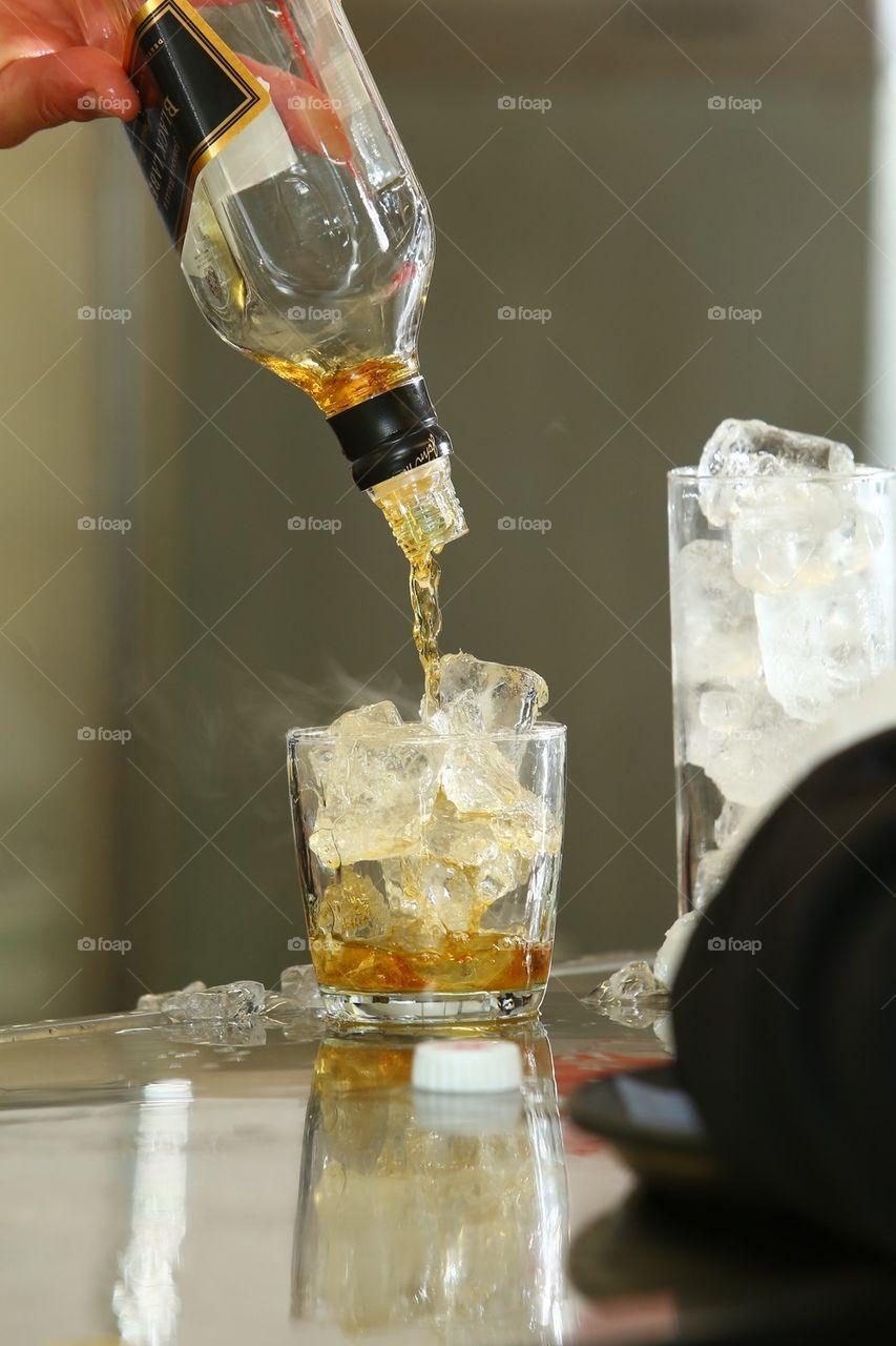 Barman serving a drink