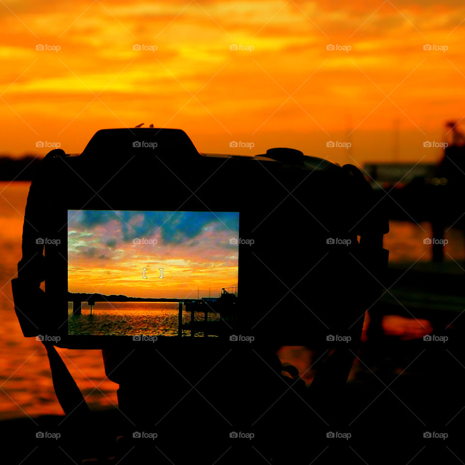 Incredible Sunsets! I am a Sunset enthusiast! The brilliant crimson, amber,tangerine, and blue hues of the sunsets sweep the sky and the surface of the waterways as the beautiful colors embrace the heavenly sky! Breathtaking!