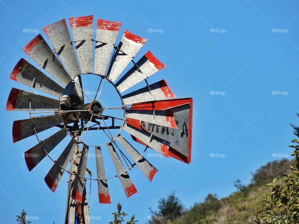 Antique Windmill. Old Fashioned Windmill On An American Farm