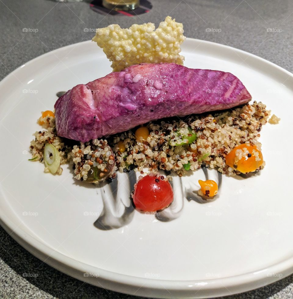 salmon served on quinoa