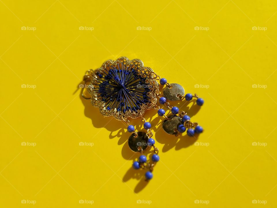 Bohemian dark blue earring with bright bold yellow backdrop