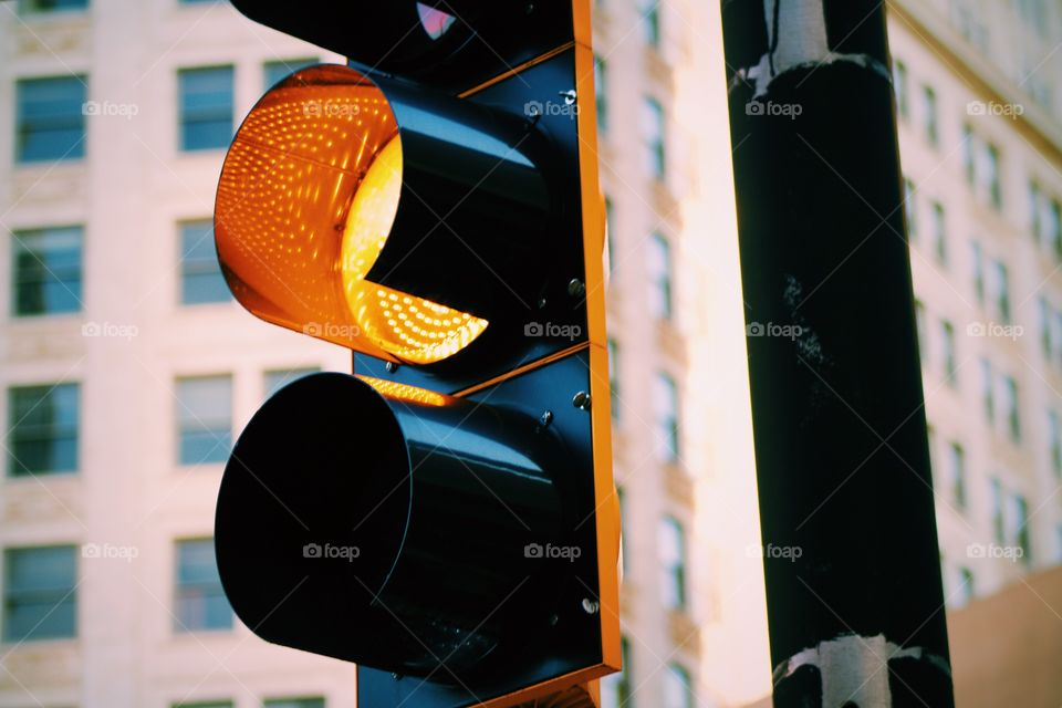 Yellow light at crossing in city