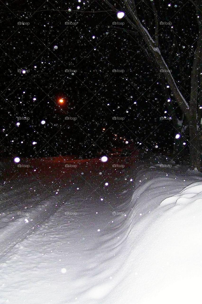 Street light shining in snow