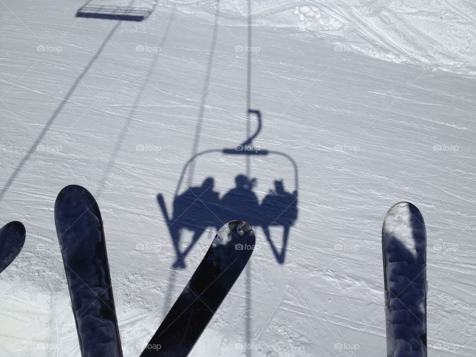 Ski lift. Shadows of skiers from lift