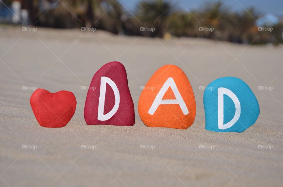 Dad word made with multi coloured stones