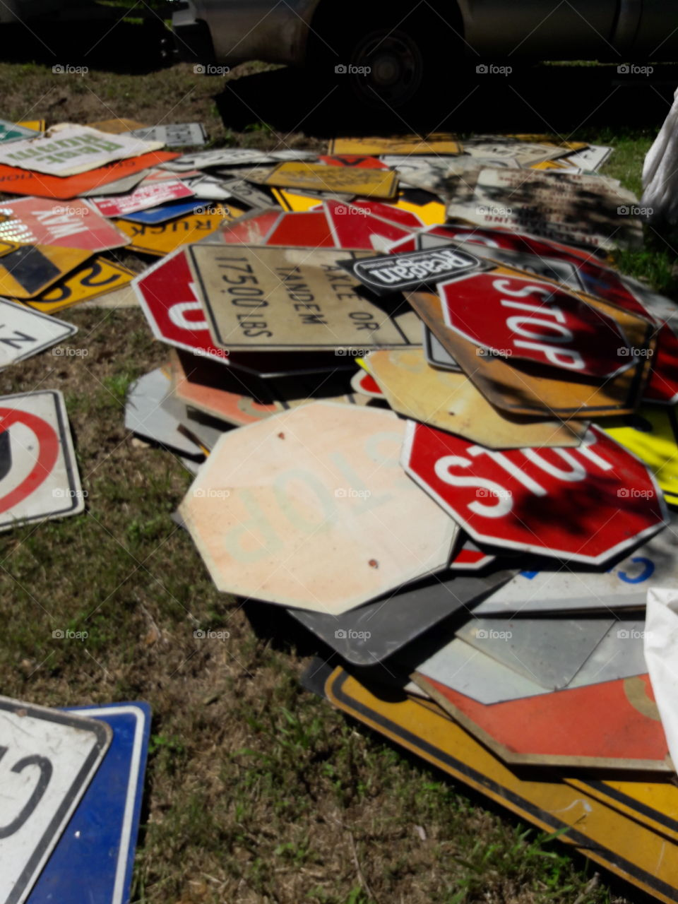 Close-up of abandoned sing boards