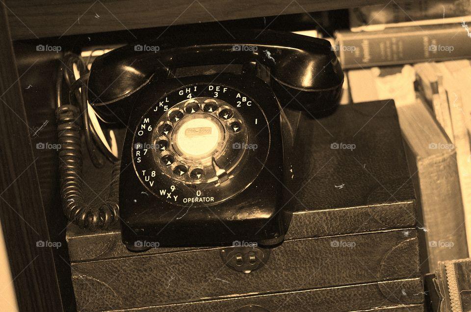 Old black rotary telephone. Old black rotary telephone