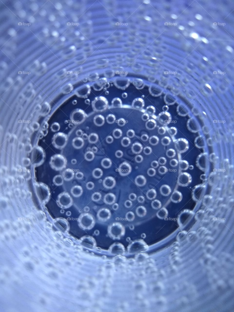 Bubbles in the glass of water