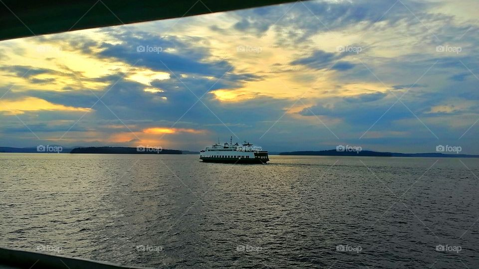 Sunset Ferry. While crossing the Puget Sound in the Pacific Northwest, I watched this ferry pass by as the sun set.