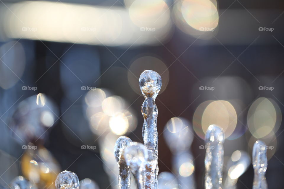 Creatively shaped icicles with bokeh light and beautiful colours