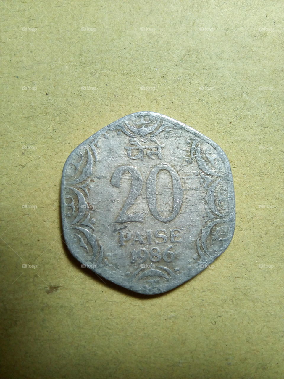 A coin of twenty paise- 1/5 share of Indian Rupee issued by Government of India in 1986.