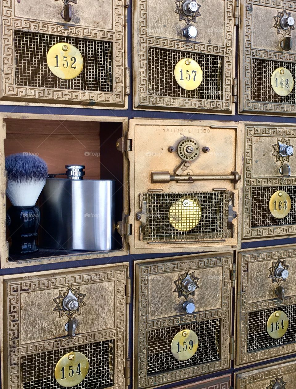 Old post office boxes, flask and shaving brush
