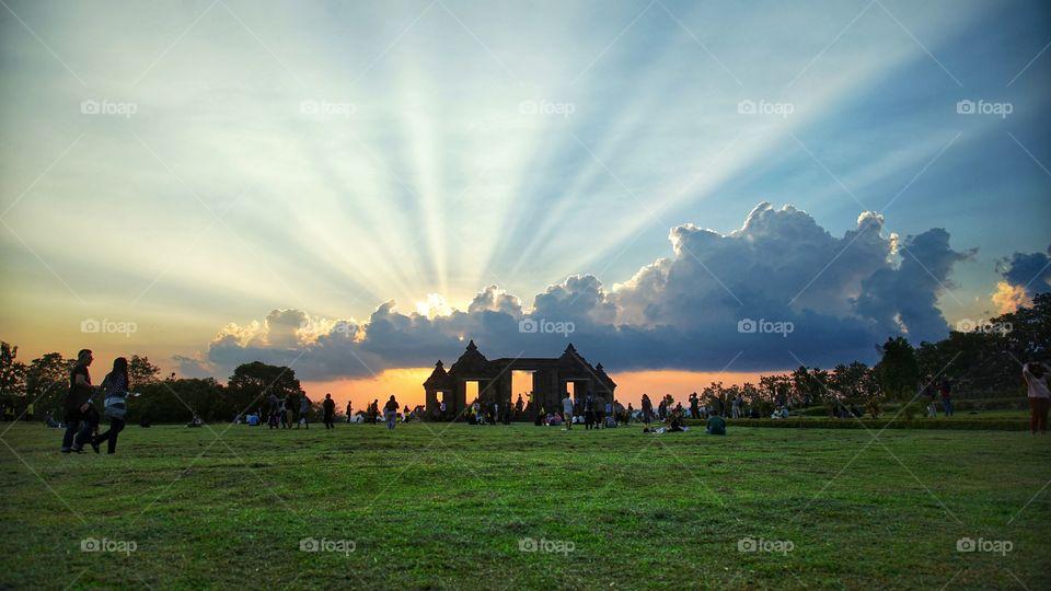 sunset view with spreading sun shine at ratu boko archaelogical site, near Jogjakarta, Indonesia