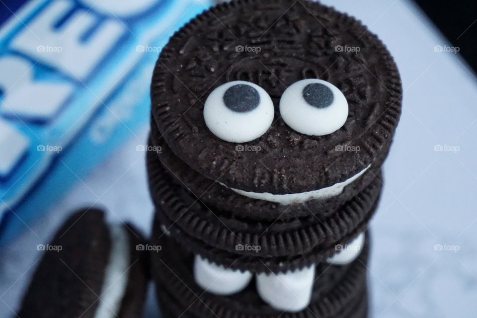 Oreo Cookie Monster with goggly eyes and marshmallow legs
