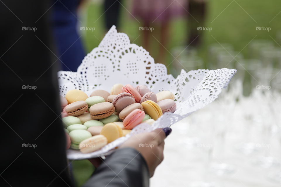 Human hand holding colorful cookies