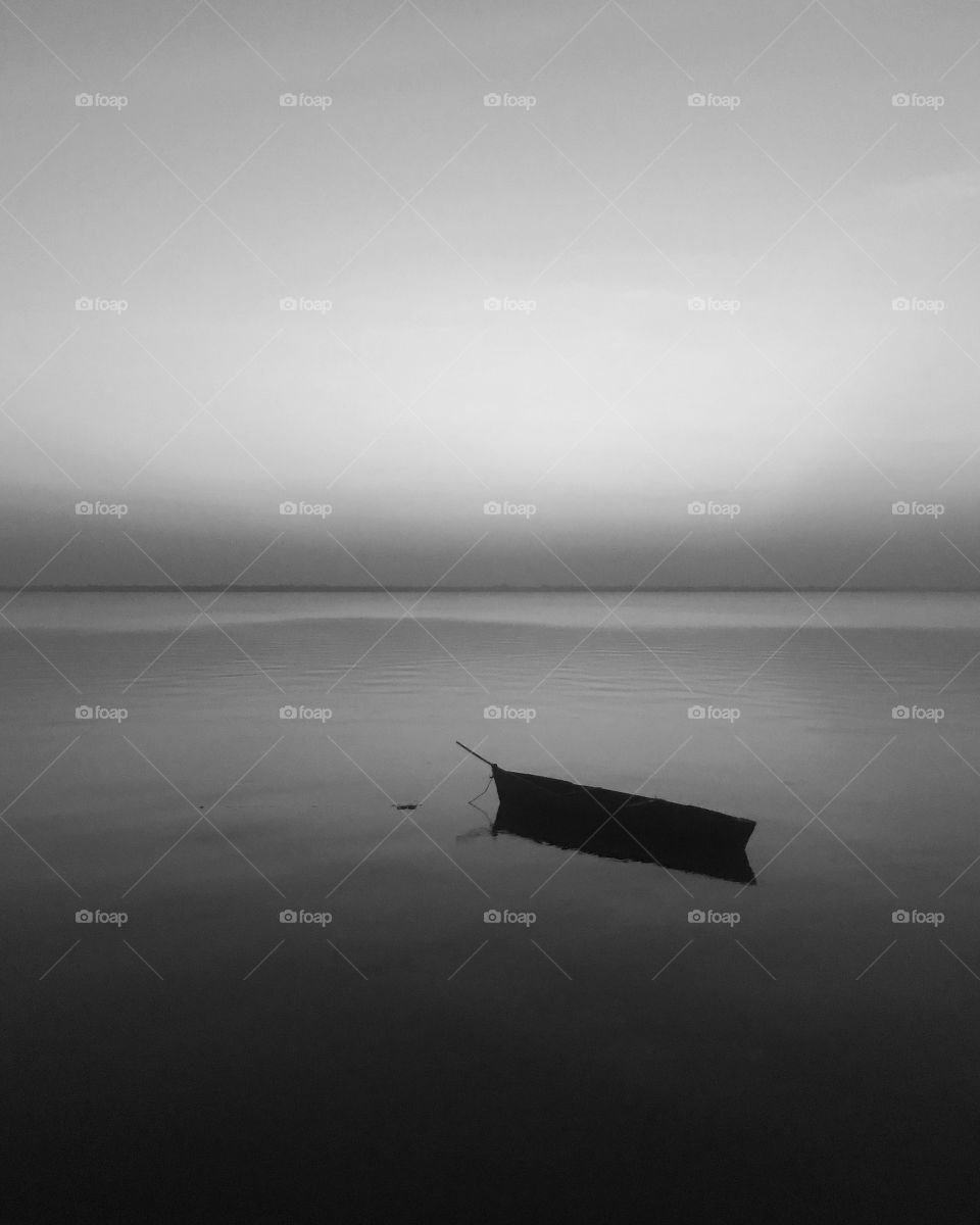 The boat in a lonely see gives the viewers a lonely dark feel and the fact that it is black and white gives it the deepest on how life is not easy on us constantly putting at us lonely place.