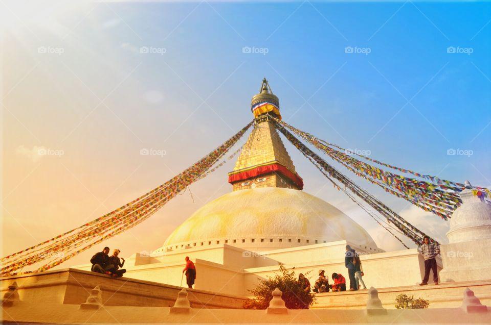Bouddanath. The stupa of bouddanath after a beautiful day. big eyes are following the sunset