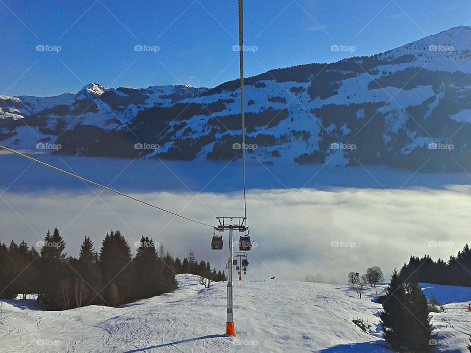 Cloudy ski day. Fog on the early ski day