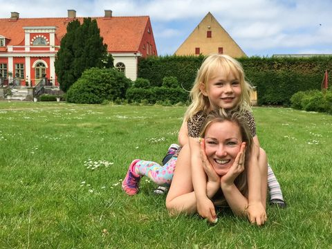 Mother and young girl posing in the grass in Katrinetorp Malmö.