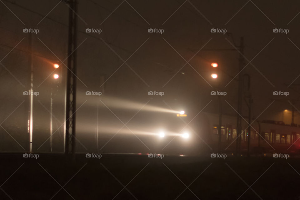 Train head lights in the mist