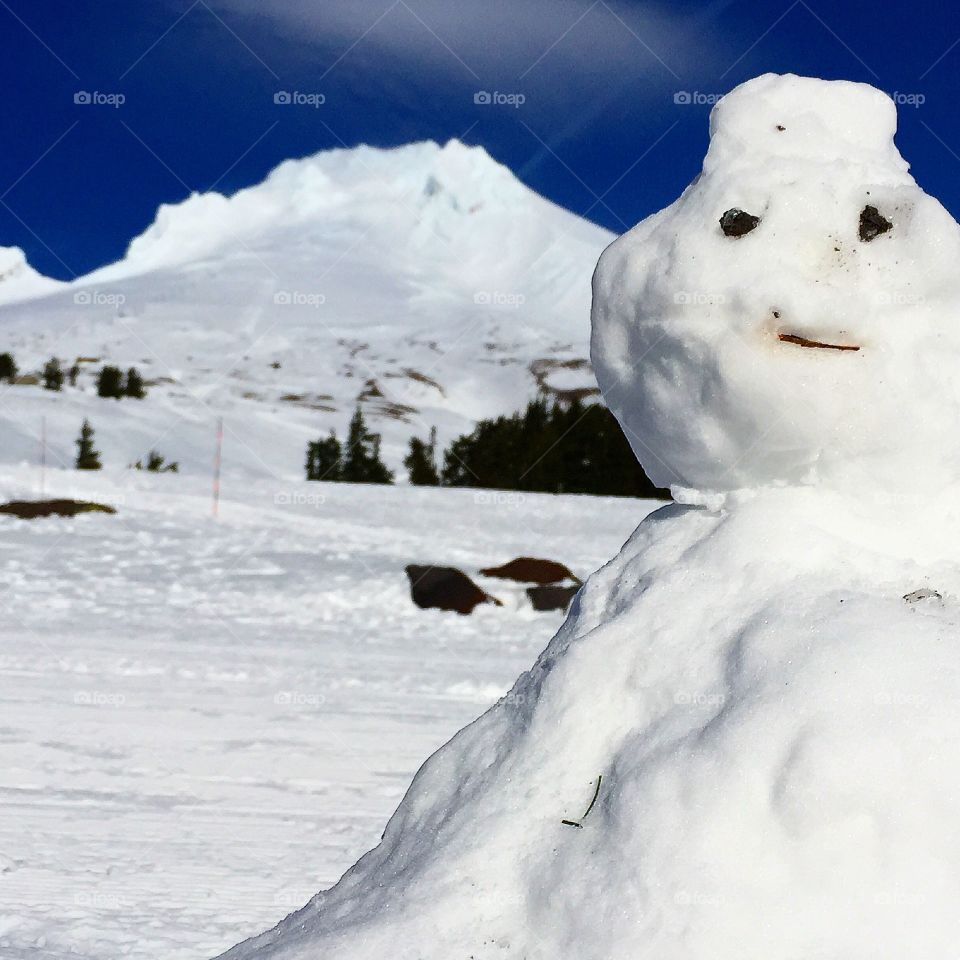 Snowman On Guard. Snowman guarding mountain