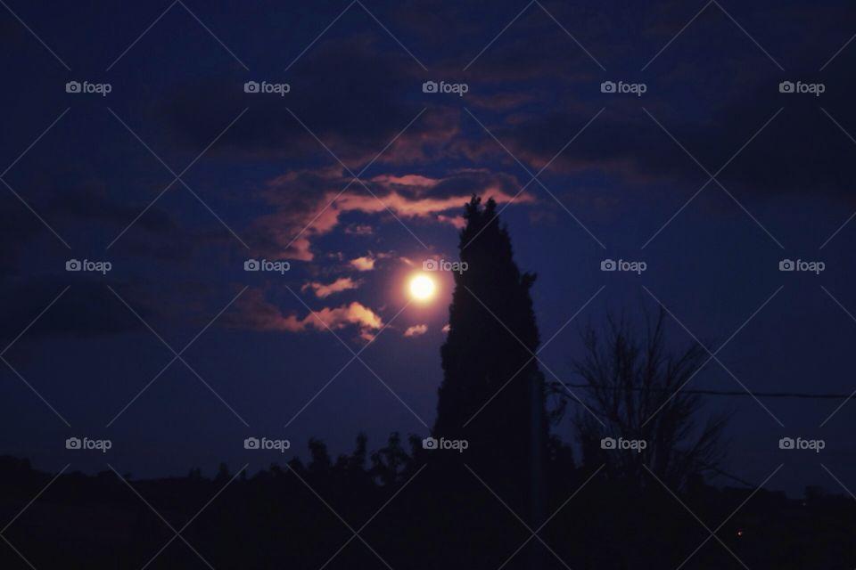 Pink moon above Montone